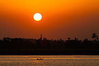 Egypt. Cruising the Nile from Kom Ombo to Luxor, passing Edfu and Esna. The sun sets on the Nile.