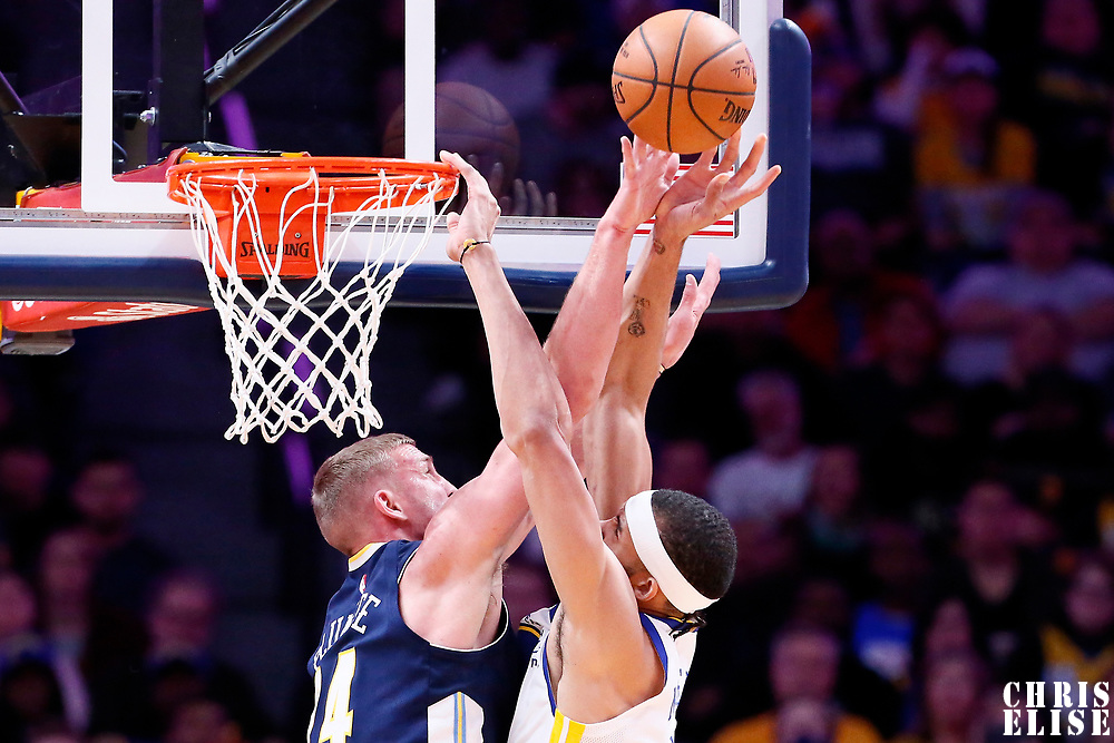 04 November 2017: Golden State Warriors center JaVale McGee (1) is blocked by Denver Nuggets center Mason Plumlee (24) during the Golden State Warriors 127-108 victory over the Denver Nuggets, at the Pepsi Center, Denver, Colorado, USA.