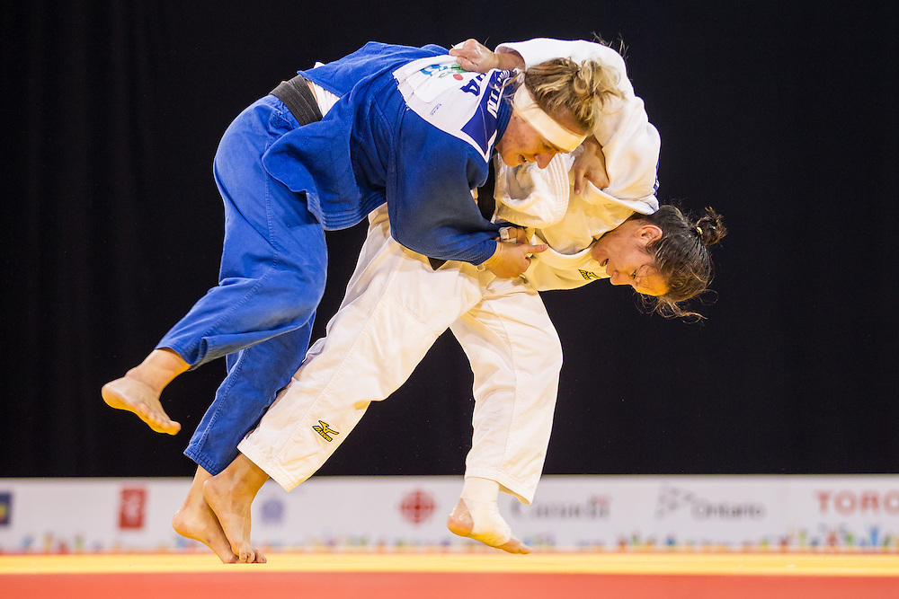 Hannah Martin (Top) of the United States is thrown by Estefania Garcia during their women's judo -63 kg final of the table at the 2015 Pan American Games in Toronto, Canada, July 13,  2015.  AFP PHOTO/GEOFF ROBINS
