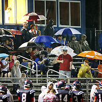 Adam Robison | BUY AT PHOTOS.DJOURNAL.COM<br /> Baldwyn fans try to stay dry as a rain shower moved through the area during the start of the third quarter against Mooreville Friday night.
