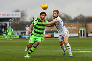 Forest Green Rovers Reuben Reid(26) and Port Vale's Nathan Smith(24) challenge for the ball during the EFL Sky Bet League 2 match between Forest Green Rovers and Port Vale at the New Lawn, Forest Green, United Kingdom on 6 January 2018. Photo by Shane Healey.