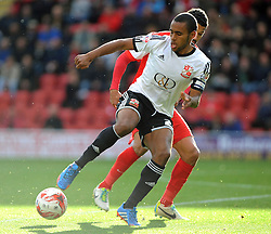 Swindon Town's Nathan Thompson holds off Leyton Orient's Jobi McAnuff - photo mandatory by-line David Purday JMP- Tel: Mobile 07966 386802 - 04/10/14 - Leyton Orient  v Swindon Town - SPORT - FOOTBALL - Sky Bet Leauge 1  - London -  Matchroom Stadium