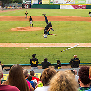 Dalton Smith, of XPogo Stunt Team, does a backflip during a demonstration between innings.