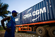 A truck driver stands near his truck outside Kpalime, Togo on Thursday October 2, 2008.