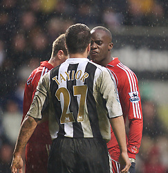 Newcastle, England - Saturday, February 10, 2007: Liverpool's Mohamed Sissoko argues with Newcastle United's Steven Taylor during the Premiership match at St James' Park. (Pic by David Rawcliffe/Propaganda)