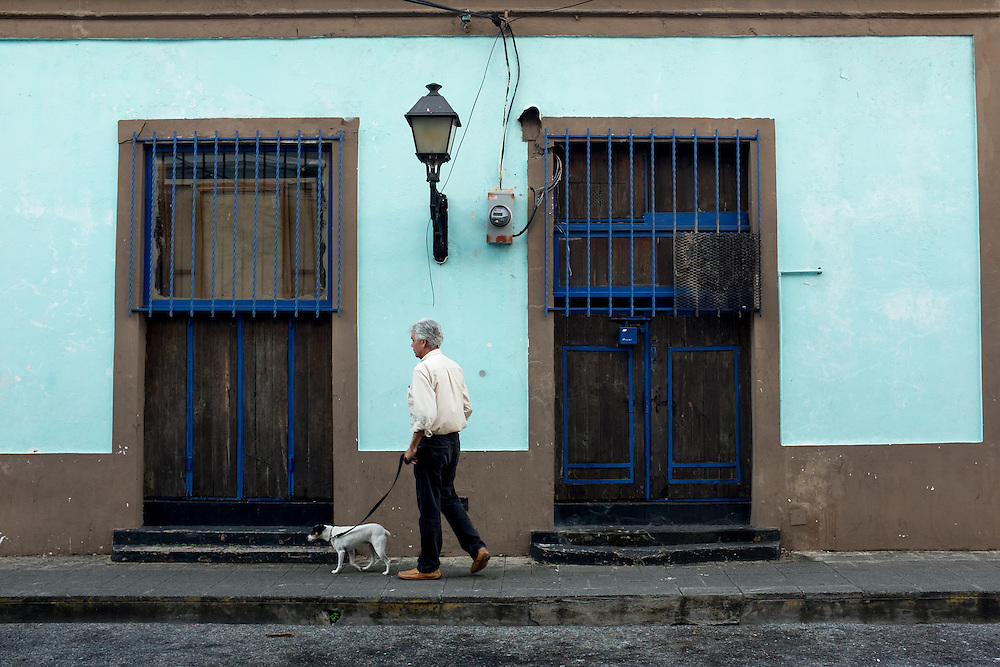 SANTO DOMINGO, DOMINICAN REPUBLIC- DECEMBER 2, 2014: Walking a dog in Santo Domingo's Zona Colonial (Colonial Zone). Story on tourism to the Caribbean Island. (Photo by Angel Valentin/Getty Images for Der Spiegel)