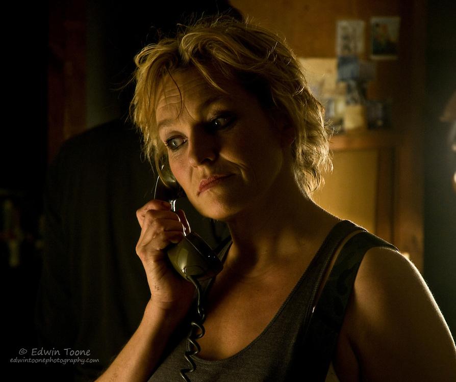 Asta talking on the phone.