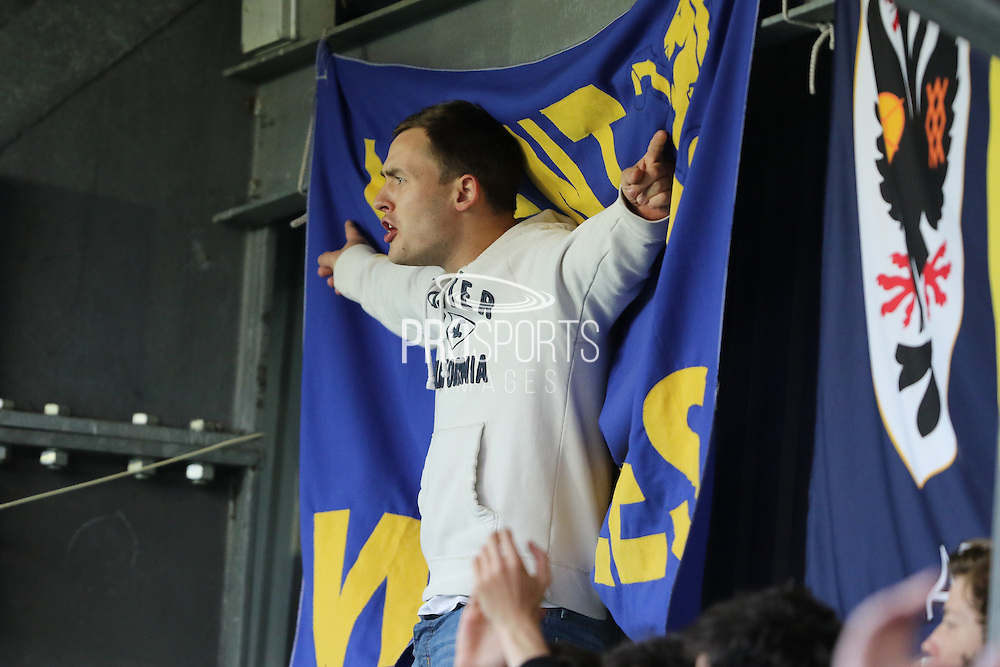 AFC Wimbledon fans get vocal during  the Sky Bet League 2 Play-Off first leg match between AFC Wimbledon and Accrington Stanley at the Cherry Red Records Stadium, Kingston, England on 14 May 2016. Photo by Stuart Butcher.