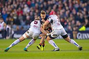 Darcy Graham (#15) of Edinburgh Rugby is sandwiched between Kieran Treadwell (#5) and Eric O'Sullivan (#1) of Ulster Rugby  during the Guinness Pro 14 2018_19 match between Edinburgh Rugby and Ulster Rugby at the BT Murrayfield Stadium, Edinburgh, Scotland on 12 April 2019.