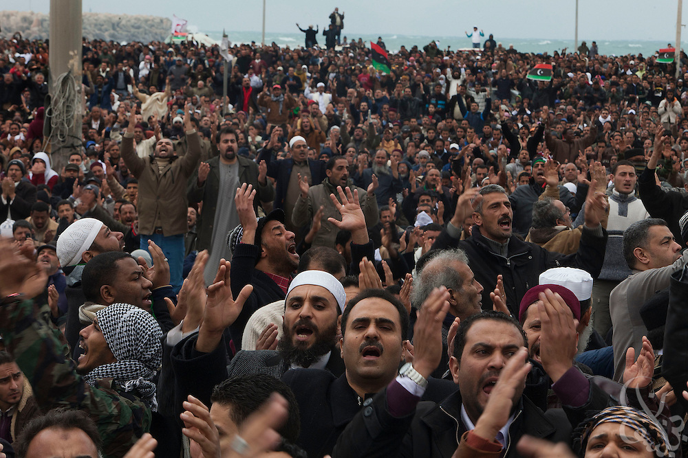 Libyan men take part in Friday prayers and a large protest February 25, 2011 in the central square of Benghazi, Libya. A crowd of at least 5,000 attended the prayers, which also included funeral prayers for three victims of the recent revolution that were laid to rest today. .Slug: Libya.Credit: Scott Nelson for the New York Times