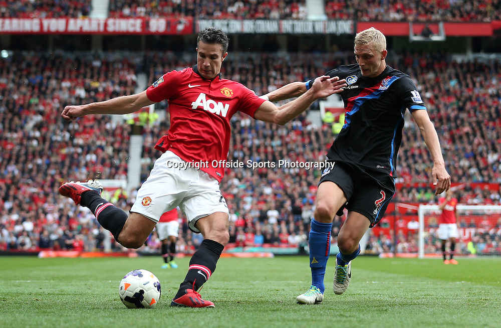14th September 2013 - Barclays Premier League - Manchester United v Crystal Palace - Robin van Persie of Man Utd battles with Dean Moxey of Palace - Photo: Simon Stacpoole / Offside.