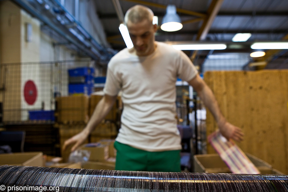 CD recycling workshop. Each prisoner makes 97 pence per 600 CD's recycled. HMP & YOI Littlehey. Littlehey is a purpose build category C prison.
