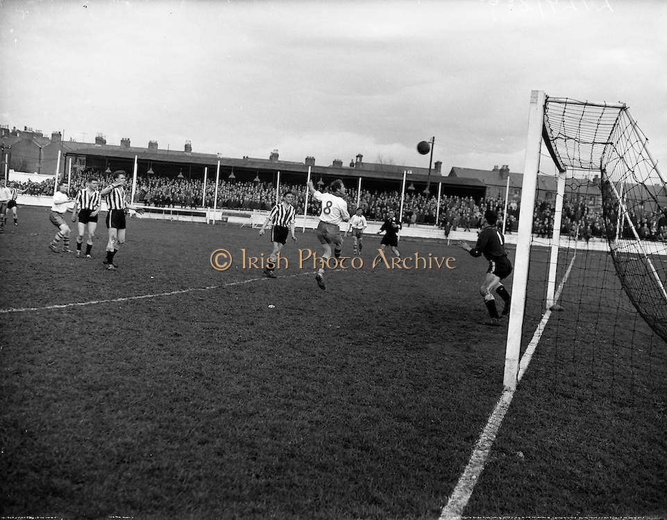 15/02/1959<br /> 02/15/1959<br /> 15 February 1959<br /> Soccer, F.A.I. Cup: Waterford v Transport at Harold's Cross, Dublin. Jack Fitzgerald heads a high ball for Waterford, while well covered by Transport keeper K. Blount and full back J. O'Reilly.