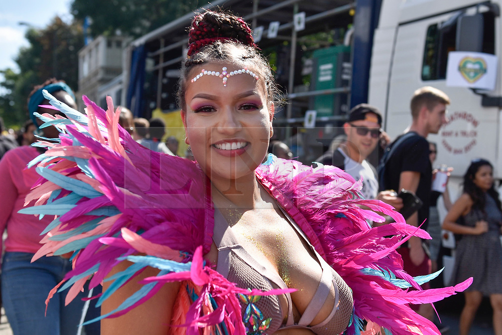 © Licensed to London News Pictures. 27/08/2017. London, UK. A performer takes part in Family Day at the Notting Hill Carnival.  Over one million revellers are expected to attend Europe's biggest street party which takes place over the Bank Holiday Weekend. Photo credit : Stephen Chung/LNP