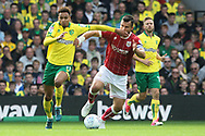 Josh Murphy of Norwich and Bailey Wright of Bristol City in action during the Sky Bet Championship match at Carrow Road, Norwich<br /> Picture by Paul Chesterton/Focus Images Ltd +44 7904 640267<br /> 23/09/2017
