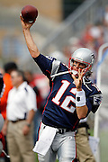 New England Patriots quarterback Tom Brady (12) throws a pass while warming up on the sideline during the NFL regular season week 3 football game against the Buffalo Bills on September 26, 2010 in Foxborough, Massachusetts. The Patriots won the game 38-30. (©Paul Anthony Spinelli)