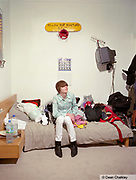 Huw, a Mod / Indie kid sat on his bed in his bedroom, Southend, UK 2006