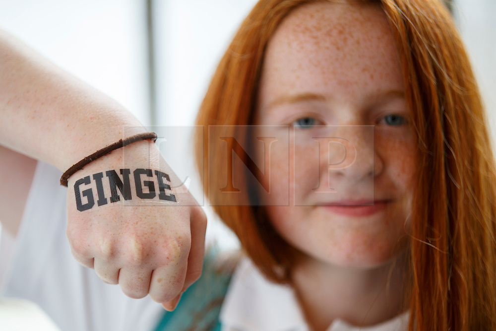 © Licensed to London News Pictures. 17/09/2016. London, UK. Libby Doughty poses with a tattoo as hundreds of redheads attend Redhead Day UK event in Angel, London on Saturday, 17 September 2016. Natural redhead visitors get chance to celebrate their ginger genes and shop specialised products, see ginger related exhibitions and live performances. Photo credit: Tolga Akmen/LNP