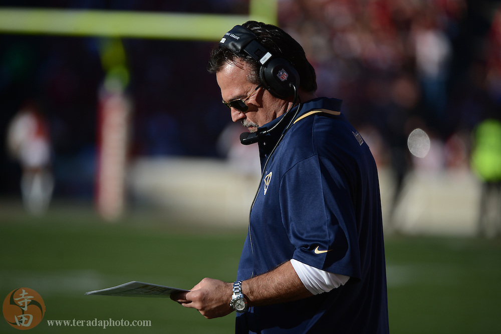 December 1, 2013; San Francisco, CA, USA; St. Louis Rams head coach Jeff Fisher looks at his play chart against the San Francisco 49ers during the third quarter at Candlestick Park. The 49ers defeated the Rams 23-13.