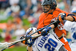 Virginia defenseman Ryan Nizolek (24) delivers a crushing check to the head of Duke midfielder Steve Schoeffel (20).  Nizolek was penalized for the play.  The #2 ranked Duke Blue Devils defeated the #3 ranked Virginia Cavaliers 11-9 in the finals of the Men's 2008 Atlantic Coast Conference tournament at the University of Virginia's Klockner Stadium in Charlottesville, VA on April 27, 2008.