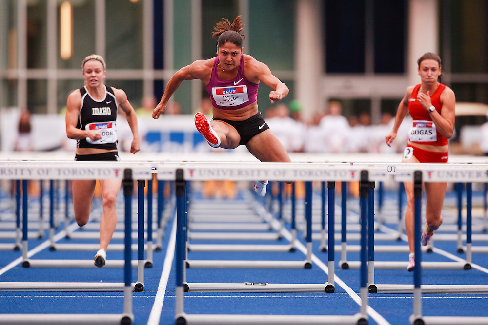 Toronto, Ontario ---10-07-31--- Priscilla Lopes-Schleip competes in the 100 metre hurdles at the 2010 Canadian Track and Field Championships in Toronto, Ontario July 31, 2010.<br />  GEOFF ROBINS/Mundo Sport Images