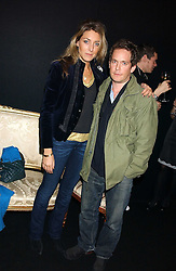 Actor TOM HOLLANDER and DIXIE CHASSAY at a party to celebrate The World of Alber Elbaz for Lanvin at Harvey Nichols, Knightsbridge, London on 1st February 2006.<br />