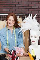 Portrait of happy female dressmaker at design studio