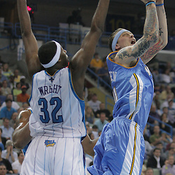 25 March 2009: Denver Nuggets center Chris Andersen (11) shoots over New Orleans Hornets forward Julian Wright (32) during a NBA game between the New Orleans Hornets and the Denver Nuggets at the New Orleans Arena in New Orleans, Louisiana.