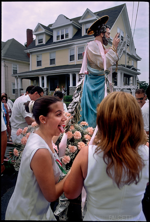 GLOUCESTER, MA:  The wives of fishermen react after placing dollars onto the statue of St. Peter during the annual celebration paying homage to St. Peter, the patron saint of fishermen in Gloucester, MA. The festa takes place on the weekend closest to the Feast Day of St. Peter, June 29. (Photo by Robert Falcetti) . .