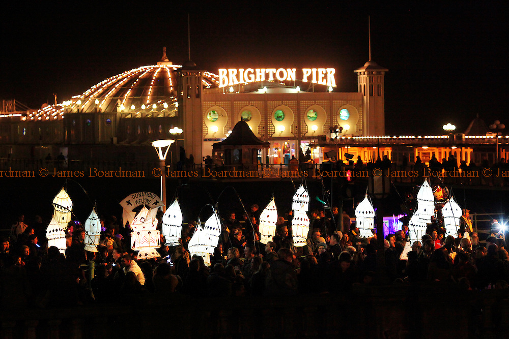 JAMES BOARDMAN / 07967642437.Revellers parade past Brighton Pier as they take part in the annual Burning the Clocks Winter Solstice Parade, which celebrates the shortest day. December 21, 2011.