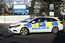 © Licensed to London News Pictures. 12/02/2020. Worthing, UK. A police car leaves Worthing Hospital where the accident and emergency unit remains open. A doctor who worked here has contracted the coronavirus. Five of the eight confirmed coronavirus cases of the coronavirus in the United Kingdom have come from Brighton on the south coast. Photo credit: Peter Macdiarmid/LNP