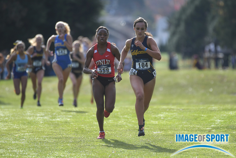 Nov 10, 2017; Seattle, WA, USA; Spencer Moore of UNLV (559) and Marissa Dobry of California (104) runs in the women's race during the NCAA West Regional cross country championships  at Jefferson Park Golf Course.