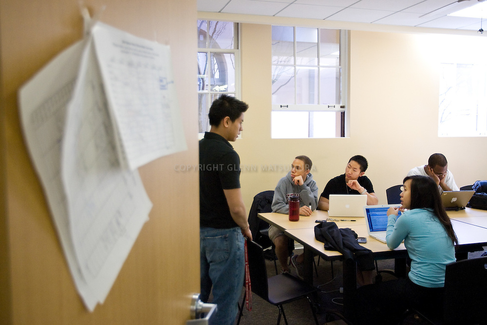 Rubberband Together.com group brainstorming meeting at Old Union, Stanford. Vivian Wang (pink top), Bernice, Richard (black top), John Dryden (white tshirt), Christophe Chong (blk top, dog tags). Group is raising awareness on breast cancer.