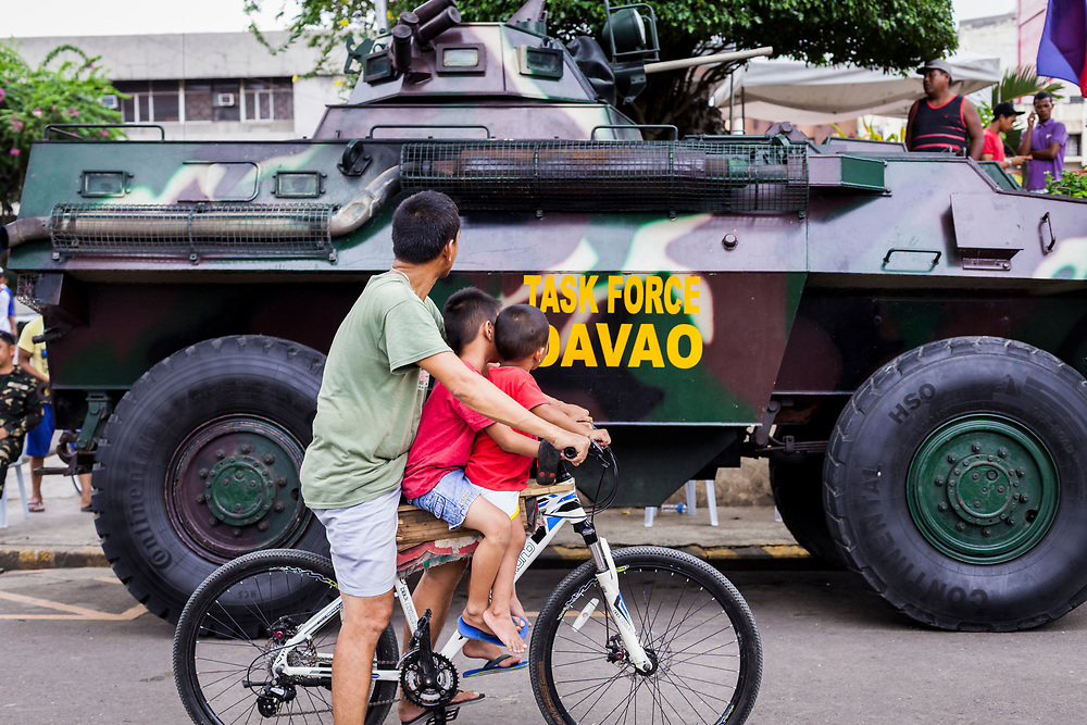 Davao City, Mindanao, Philippines - JUNE 18: Davao Task Force Army tank is seen at Quezon Park near Davao City Hall.  Security in the city is tight since President Duterte implemented a Martial Law for 60 days in Mindanao due to the heavy fighting in Malawi 250km away.