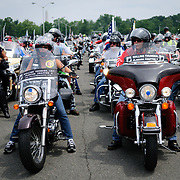 Lines of bikers participating in the annual Rolling Thunder motorcycle rally through downtown Washington DC on May 29, 2011. This shot was taken as the riders were leaving the staging area in the Pentagon's north parking lot, where thousands of bikes and riders had gathered.
