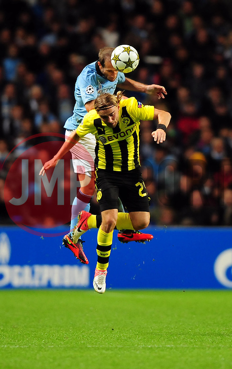 Manchester City's Pablo Zabaleta battles for the high ball with Borussia Dortmund's Marcel Schmelzer - Photo mandatory by-line: Joe Meredith/JMP  - Tel: Mobile:07966 386802 03/10/2012 - Manchester City v Borussia Dortmund - SPORT - FOOTBALL - Champions League -  Manchester   - Etihad Stadium -