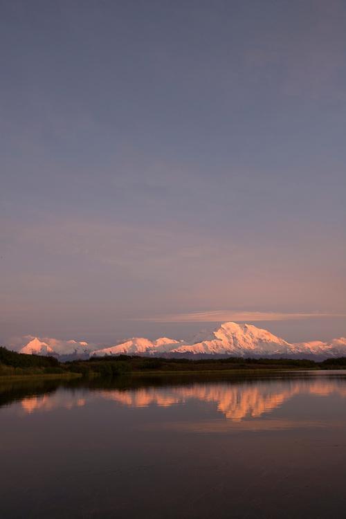 USA, Alaska, Denali National Park, Mount McKinley and Reflection Pond at sunset on autumn evening