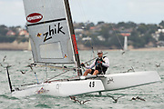 Nathan Outteridge (AUS1004), race seven of the A Class World championships regatta being sailed at Takapuna in Auckland. 15/2/2014