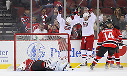 Feb 27, 2014; Newark, NJ, USA; Columbus Blue Jackets center Artem Anisimov (42) celebrates his goal on New Jersey Devils goalie Cory Schneider (35) during the first period at Prudential Center.