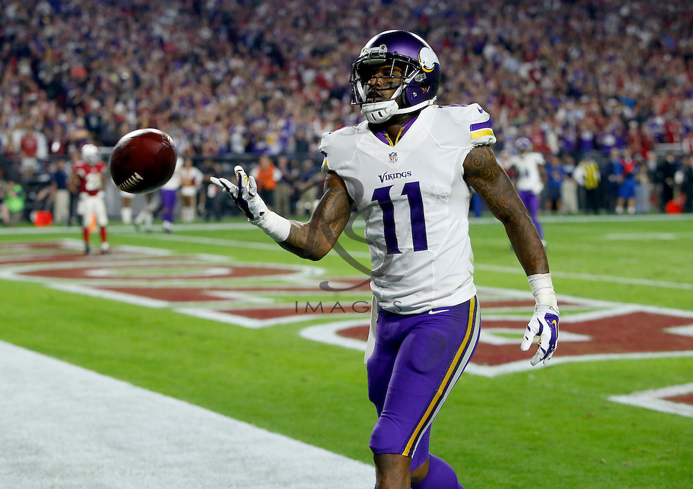 Minnesota Vikings wide receiver Mike Wallace (11) tosses the ball to the official after a touchdown catch against the Arizona Cardinals during the second half of an NFL football game, Thursday, Dec. 10, 2015, in Glendale, Ariz. (AP Photo/Rick Scuteri)