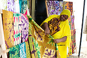 Salma Likupila folding up a Batik in her shop near Picha ya Ndege in Tanzania.<br /> <br /> Salma set up and now runs a Batik business, making and selling Batik as well as towels and bed linen.<br /> <br /> She attended MKUBWA enterprise training run by the Tanzania Gatsby Trust in partnership with The Cherie Blair Foundation for Women.