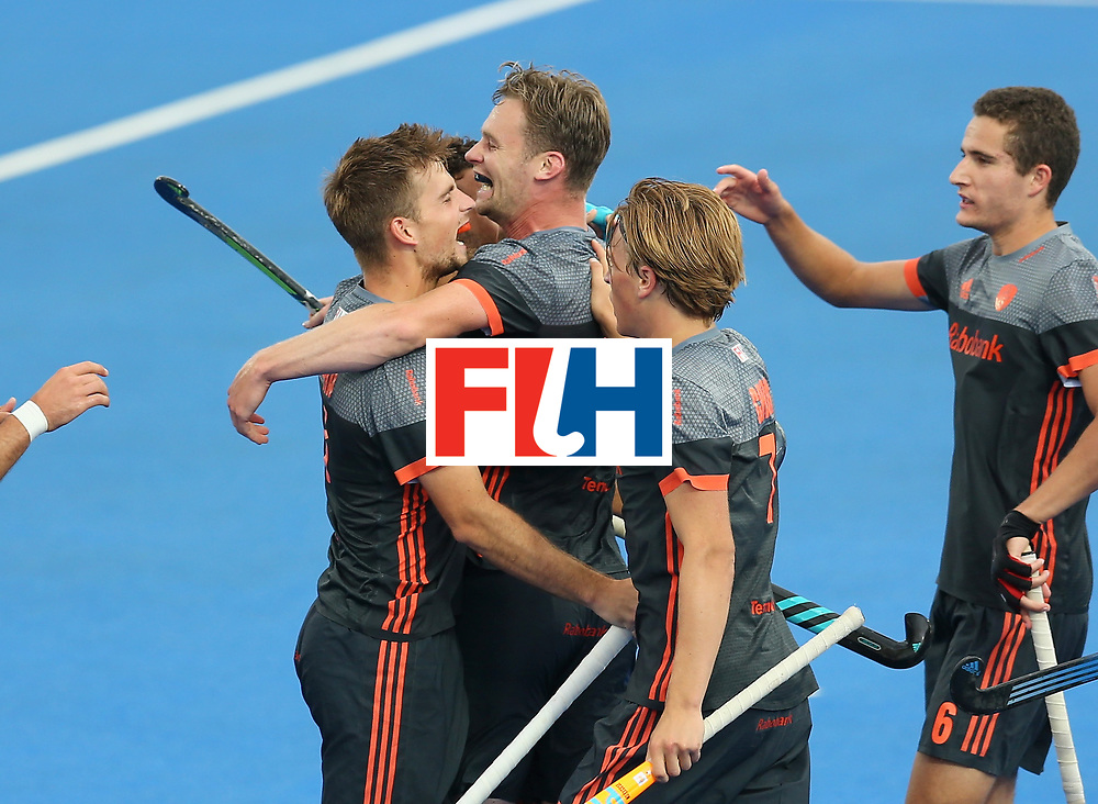 LONDON, ENGLAND - JUNE 24:  Mirco Pruijser of the Netherlands celebrates scoring their teams first goal with teammates during the semi-final match between England and the Netherlands on day eight of the Hero Hockey World League Semi-Final at Lee Valley Hockey and Tennis Centre on June 24, 2017 in London, England.  (Photo by Steve Bardens/Getty Images)