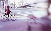 Japanese people in the trendy shopping district of Sakae, Nagoya. Photo taken using a selective focus lens on positive slide film.