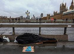 FILE IMAGE © Licensed to London News Pictures. 26/11/2019. London, UK. A homeless man makes his home for the night on Westminster Bridge. Pictures highlight the reality of homelessness in Westminster taken during the build up of Brexit and the General election just a few hundreds yards from Parliament and Downing Street. Photo credit: Alex Lentati/LNP