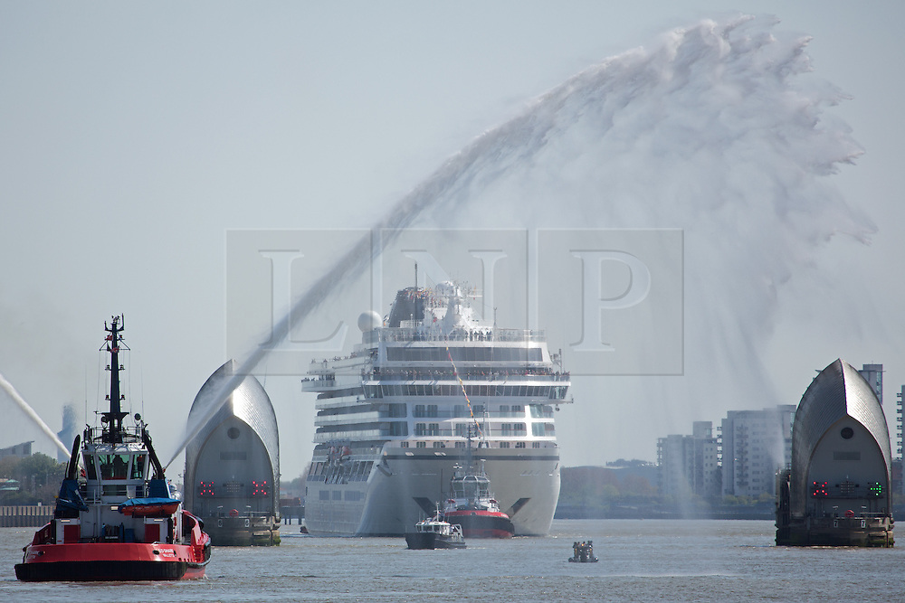 © Licensed to London News Pictures. 05/05/2016. Viking Sea at the Thames Barrier. Brand new cruise ship Viking Sea has arrived in London for a christening ceremony at Greenwich. The 227 metre long cruise ship carries 930 passengers and is the biggest cruise ship to ever be christened in London. Credit : Rob Powell/LNP