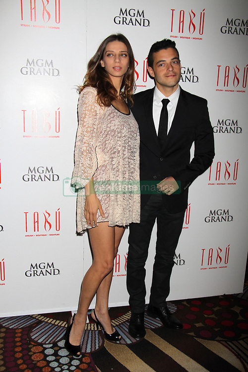 Rami Malek and Angela Sarafyan attending a photocall at Tabu Nightclub in Las Vegas.