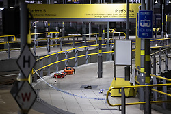 © Licensed to London News Pictures . FILE PICTURE DATED 31/12/2018 of a deployed taser , medical equipment and a shoe on a platform at Victoria Station in Manchester as Mahdi Mohamud is due to appear at Manchester Crown Court today (Tuesday 26 November 2019) charged  with 3 counts of attempted murder and 1 count contrary to Section 58 (1) (a), TACT 2000 which relates to the possession of a document or record likely to be useful to a person committing or preparing an act of terrorism . On the evening of 31st December 2018 , as thousands headed in to Manchester City Centre to watch New Years Day fireworks , three people including a British Transport Police Officer were stabbed and a man was tasered on a Metrolink platform of Victoria Train Station in Manchester . Photo credit : Joel Goodman/LNP