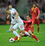 Montenegro's Filip Kasalica and Jakub Blaszczykowski of Poland during the FIFA World Cup 2014 group H qualifying football match of Poland vs Montenegro on September 6, 2013 in Warsaw, <br />Photo by: Piotr Hawalej