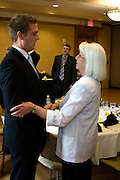 10. Muriel Ballou, one of the faculty members for the Ohio University without Boundaries program, gives Vincent van Assendelft, 25, a hand shake at the Ohio University without Boundaries luncheon and award ceremony. This is the 50th group from Sogeti to come through the Ohio University without Boundaries.