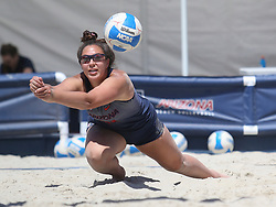 April 7, 2018 - Tucson, AZ, U.S. - TUCSON, AZ - APRIL 07: Arizona Wildcats defender Sara Watanabe (44) dives to hit the ball during a college beach volleyball match between the California Golden Bears and the Arizona Wildcats on April 07, 2018, at Bear Down Beach in Tucson, AZ. Arizona defeated California 3-2. (Photo by Jacob Snow/Icon Sportswire (Credit Image: © Jacob Snow/Icon SMI via ZUMA Press)